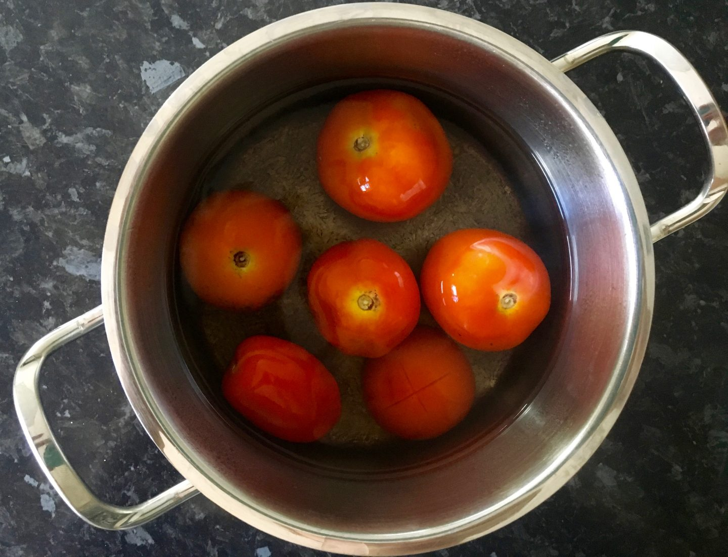 Using hot water to peel tomatoes