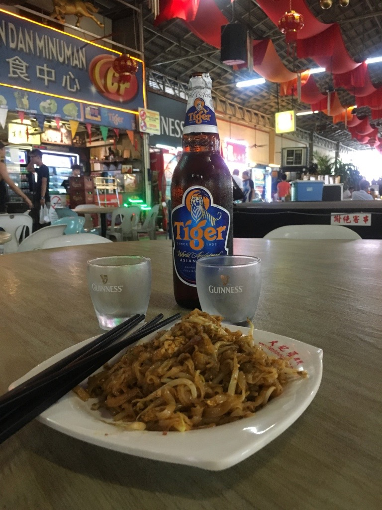 char kway teow with cold beers in Penang
